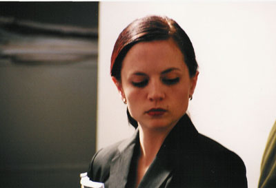 Melissa (Sarah Louise Lilley) refuses Katie entrance to her husband's office.